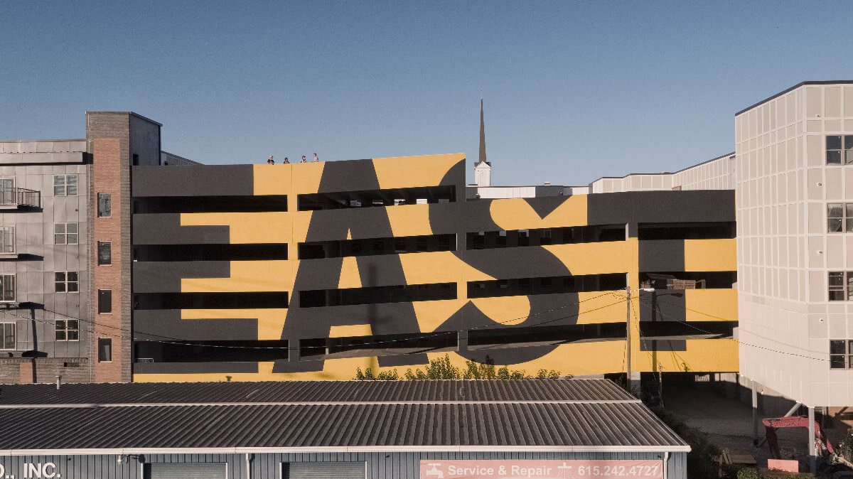 Eastside Heights western facade showcases the EAST wall mural