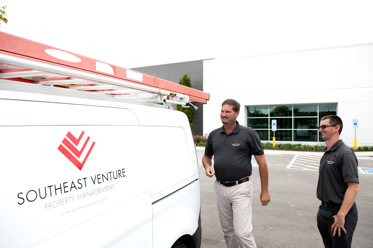 Southeast Venture Property Maintenance Van and two of the maintenance technicians
