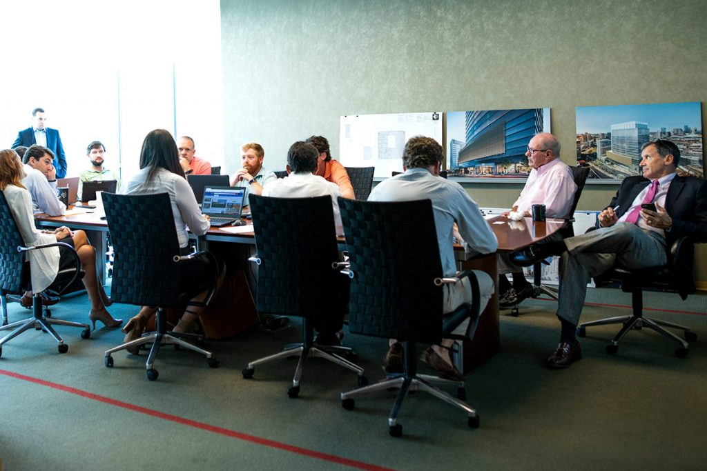 the brokerage department gathers for a team meeting