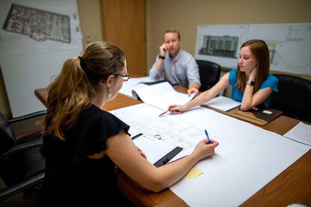 designers review construction documents